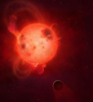 The planet Kepler-438b is shown here in front of its parent star, which researchers have discovered powerful flares of radiation, which could render the planet uninhabitable.