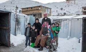 The Karkour family, pictured outside their tent in an informal refugee settlement in Arsal.