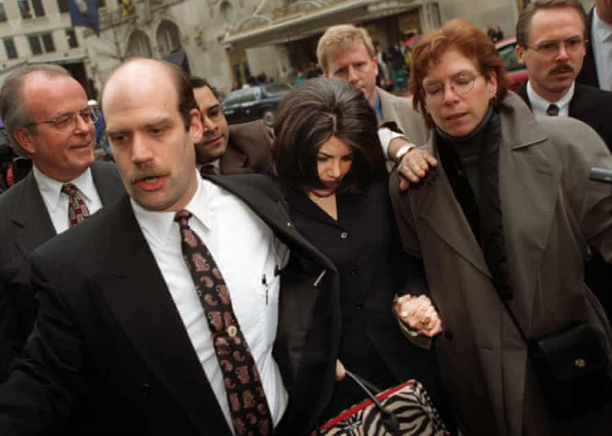 Lewinsky, escorted by members of her team, in Washington in February 1999