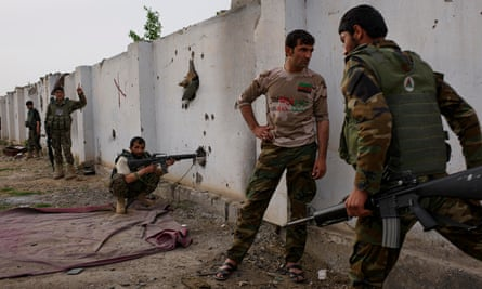 Afghan national army soldiers take positions inside a school in Chahe Anjir, not far from Lashkar Gah, the capital of Helmand.