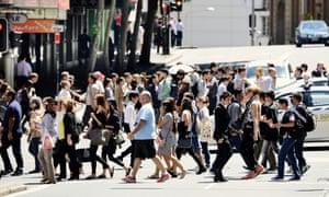 People crossing sunlit street