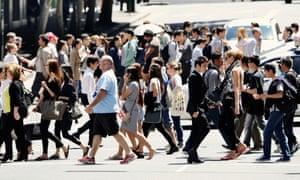 People crossing the street in Sydney, Australia