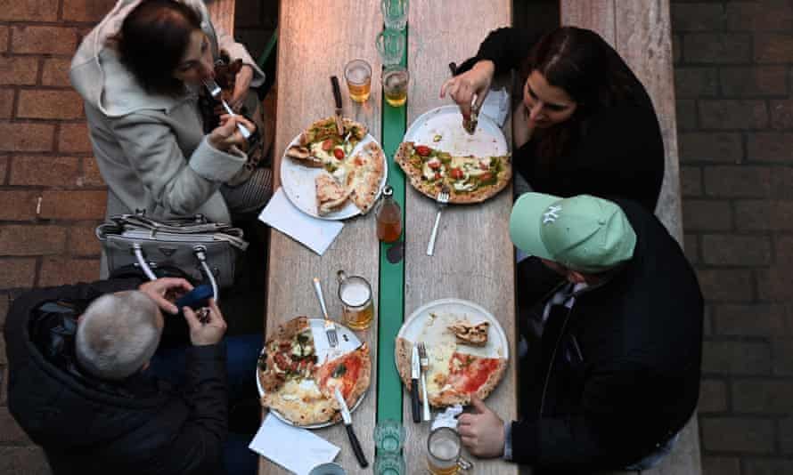 Customers dine in Soho. London and parts of the south-east will enter tier 3 coronavirus restrictions from 16 December.