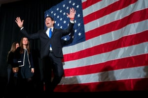 Marco Rubio gestures as he arrives at his primary night rally at the Radisson Hotel in Manchester, New Hampshire.
