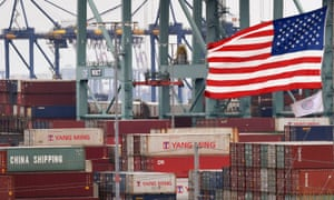 Chinese shipping containers near a US flag after they were unloaded at the Port of Los Angeles, California