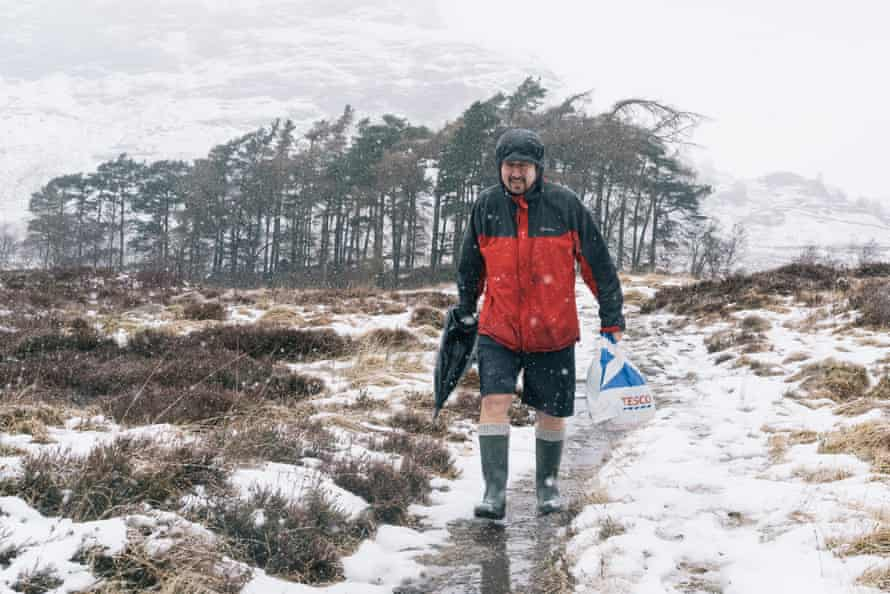 Davy McDonald carrying supplies back to his camp