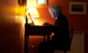 Older woman upsing a laptop at home