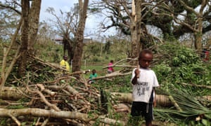 Children among debris while residents deal with the damage to their homes in Seaside, near the Vanuatu capital of Port Vila.