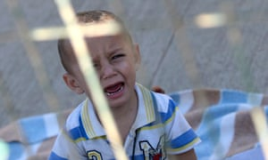A young Syrian migrant waits in a holding centre for immigrants in the Spanish enclave of Melilla in north Africa.