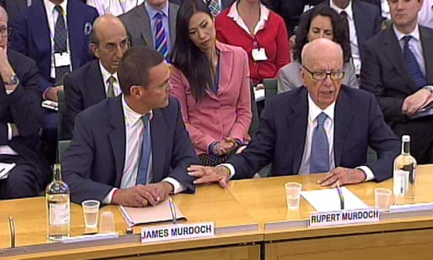 James (left) and Rupert Murdoch giving evidence to the culture, media and sport select committee in 2011.