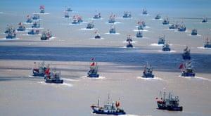 Fishing boats set sail in the East China Sea off Zhoushan, China