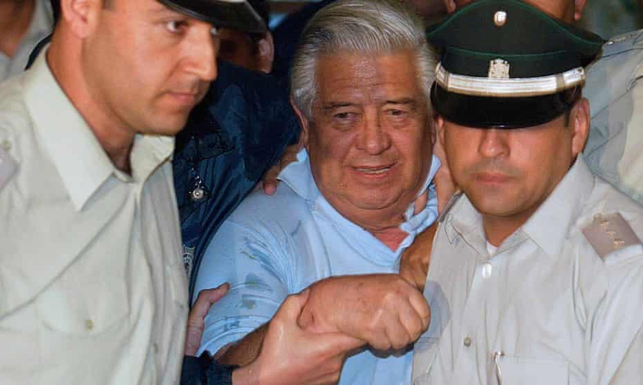 Manuel Contreras (centre) and two police officers