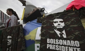 A supporter of Brazil's rightwing presidential candidate Jair Bolsonaro sells T-shirts at a bus station in Brasília, Brazil.