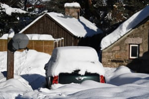 Braemar, UK. A car sits in a driveway covered by snow in Braemar in Scotland. A low of -23C was recorded overnight in the Scottish Highlands by the Met Office