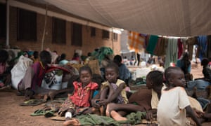 Children wait to be registered among the displaced in a South Sudan Red Cross compound in Wau