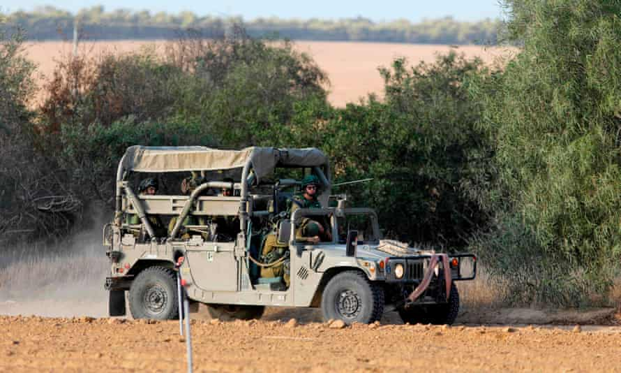 Israeli soldiers patrol close to the Israeli border with Gaza.