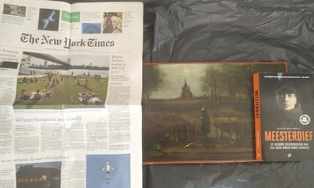 A photo of a painting believed to be Van Gogh's stolen work and a copy of the New York Times