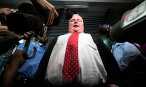 Toronto Mayor Rob Ford responds the media at City Hall in Toronto, October 31, 2013.