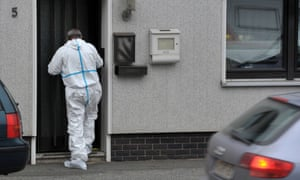 A crime scene specialist enters a house in Wallenfels where the bodies of eight infants were discovered.