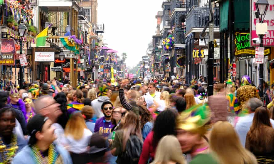 People in The French Quarter on the final day of Mardi Gras in New Orleans on 25 February.