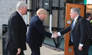 Boris Johnson shakes hands with MP Simon Baynes as he arrives at the Welsh Conservative party conference in Wales on 6 March.