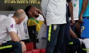 Neymar reacts after suffering an injury against Qatar.