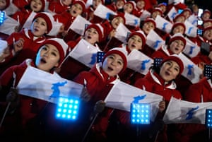 Cheerleaders for North Korea, competing under the unified flag, await the start of the opening ceremony. Each of the seats in the stadium had a light box behind it that could change colour to represent the flag of each nation upon entrance to the arena