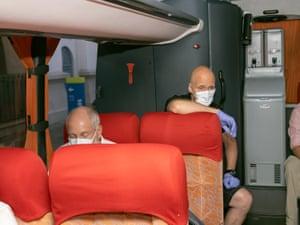 Antarctic expedition guide Steve Egan and an Ocean Atlantic passenger on board a bus
