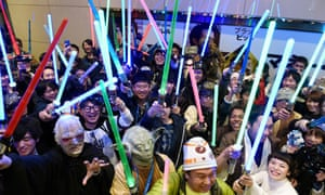 Star Wars fans pose for photographs at a cinema prior to the 'Star Wars: The Force Awakens' opens on December 18, 2015 in Tokyo, Japan. The film was set to break all opening weekend sales records. (Photo by The Asahi Shimbun via Getty Images)