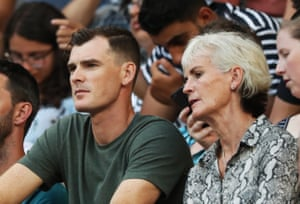 His mother, Judy, and brother, Jamie, watch the game