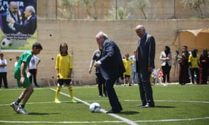 Former Fifa president Sepp Blatter kicks off a match in Ramallah, West Bank, in 2015 as Jibril Rajoub, president of the Palestinian FA, looks on.