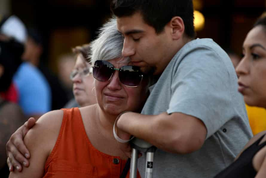 Justin Bates, who was injured in the Gilroy garlic festival mass shooting, and his mother, Lisa Barth, attend a vigil outside of city hall, in Gilroy, California, on 29 July 2019.