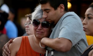 Justin Bates, a survivor of the Gilroy Garlic Festival mass shooting, and his mother, Lisa Barth, attend a vigil outside of Gilroy city hall.