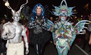 People attend the West Hollywood Halloween costume carnival in Los Angeles