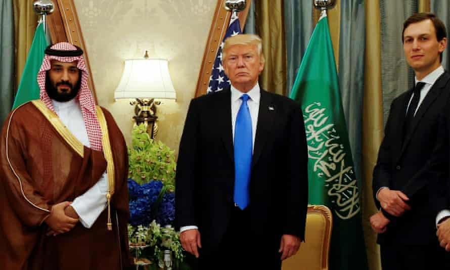 Donald Trump flanked by Saudi Arabia's Crown Prince Mohammed bin Salman and Jared Kushner