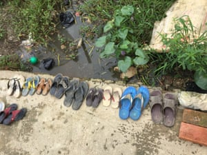 Children's shoes lined up outside the front door of a private orphanage in Myanamar.