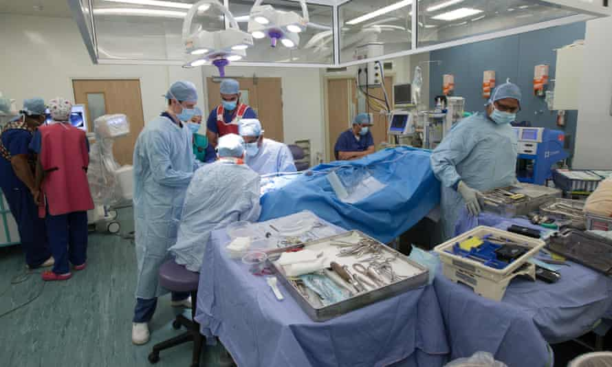 NHS staff in an operating theatre