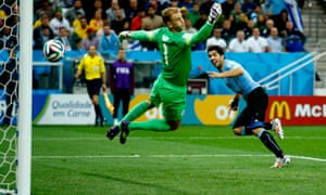 Luis Suárez scores Uruguay's first goal against England at the 2014 World Cup to leave Joe Hart flailing.