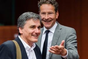Euclid Tsakalotos and Jeroen Dijsselbloem chatting at today's meeting.