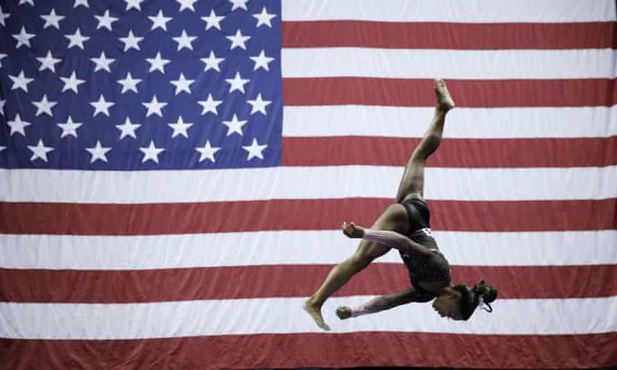 Simone Biles competes in the beam during the senior women's competition at the US gymnastics championships on Sunday.