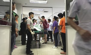 A wounded Chinese national lies on a stretcher at the Police General Hospital. Hospitals have called for interpreters and blood donors