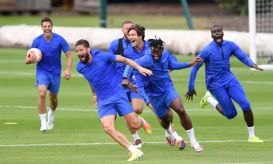 Olivier Giroud leads the way at a happy Chelsea training session.