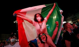 Italy fans celebrate after Italy's Ciro Immobile scored their second goal.