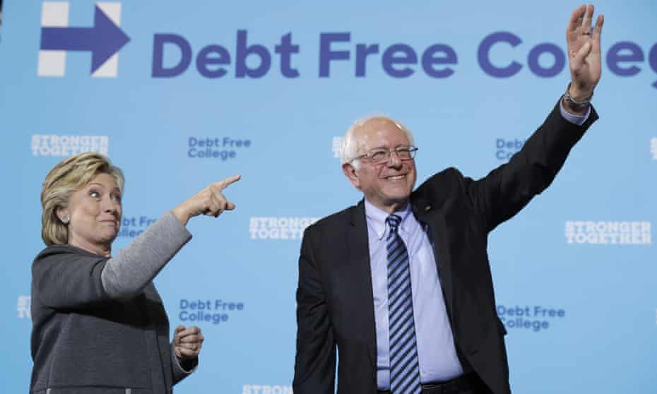Hillary Clinton and Bernie Sanders acknowledge the audience at a campaign stop in September 2016.
