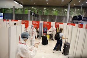 A passenger leaves after being tested for coronavirus at the Roissy Charles de Gaulle airport, outside Paris, on Saturday, 1 August, 2020.