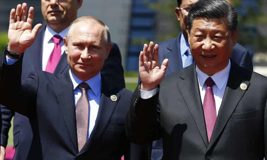 Hosting Vladimir Putin in Beijing.