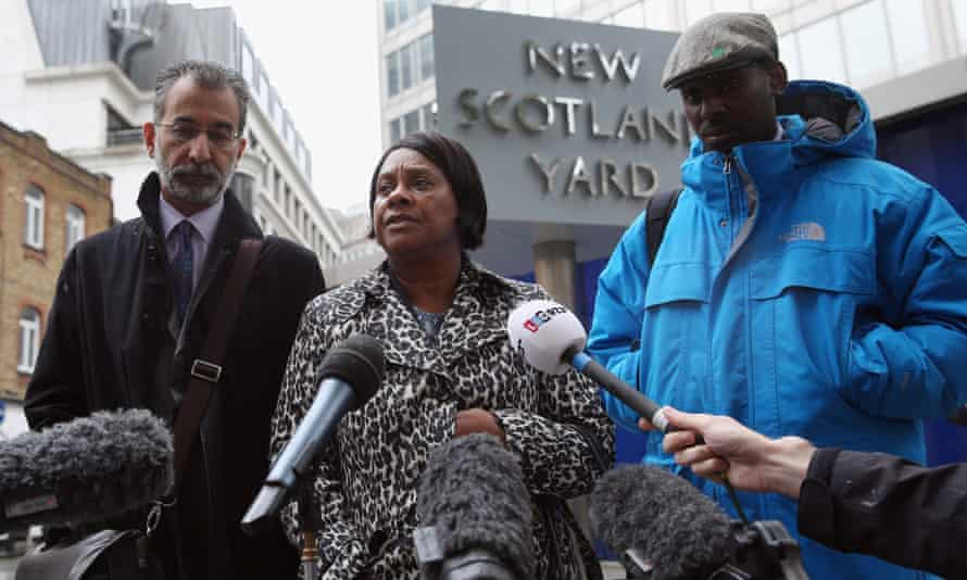 Doreen Lawrence (C), the mother of Stephen Lawrence, addresses the media, with her son Stuart Lawrence (R) and the Lawrence family solicitor Imran Khan in 2013.