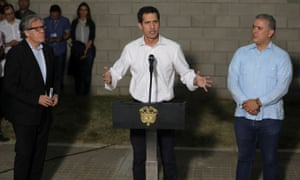Venezuelan opposition leader Juan Guaido, talks to the media next to Colombia's President Ivan Duque (right) and Organization of American States (OAS) Secretary General Luis Almagro (left).