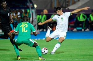 Baghdad Bounedjah's shot takes a wicked deflection on Sané.