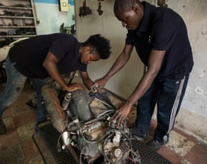 Mechanics Balde (left) and Magassa are proud of the 'happy' life they have in Riesi